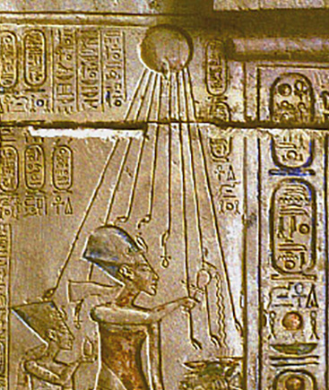 The Aten as a sun disk streaming down rays to the faces of Akhenaten and Nefertiti.