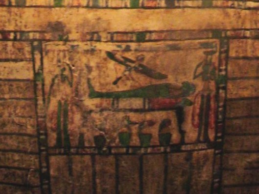 Funerary scene on the front of the coffin